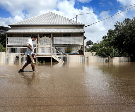 A resident walks through flood waters in the suburbs of Brisbane in 2011. Image: Brad Marsellos, ABC Open