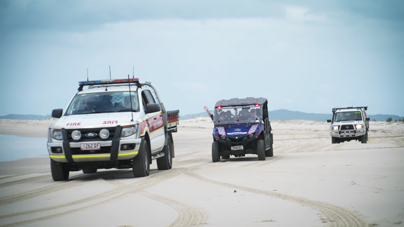 Emergency service vehicles on beach