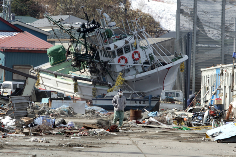 Damaged ship and property after tsunami in Japan.