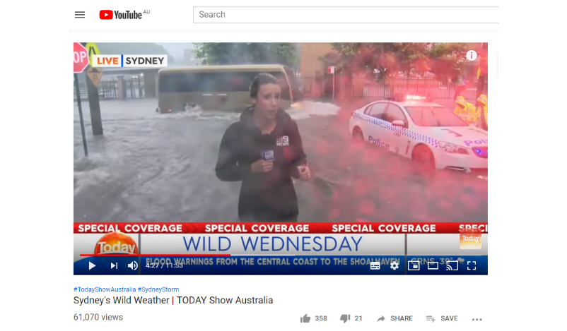 Figure 6:  A still image from a Channel 9 Today Show online video reporting bad weather in Sydney, NSW (27 Nov 2019) and showing professionals standing in and driving through floodwater (journalist, police, bus driver).