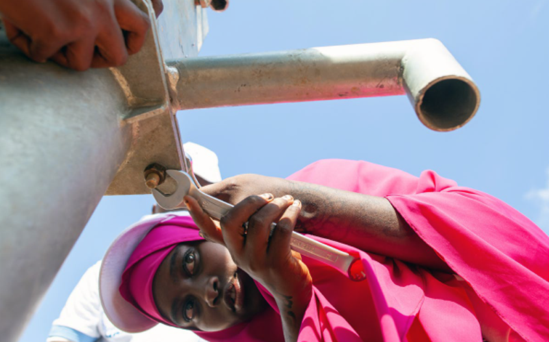 Muslima, age 18, from Somalia learns how to install a water pump at a centre that provides training to displaced youth in construction, engineering and plumbing. Image: ©2019 UNICEF/UNI226037/Mark Naftalin
